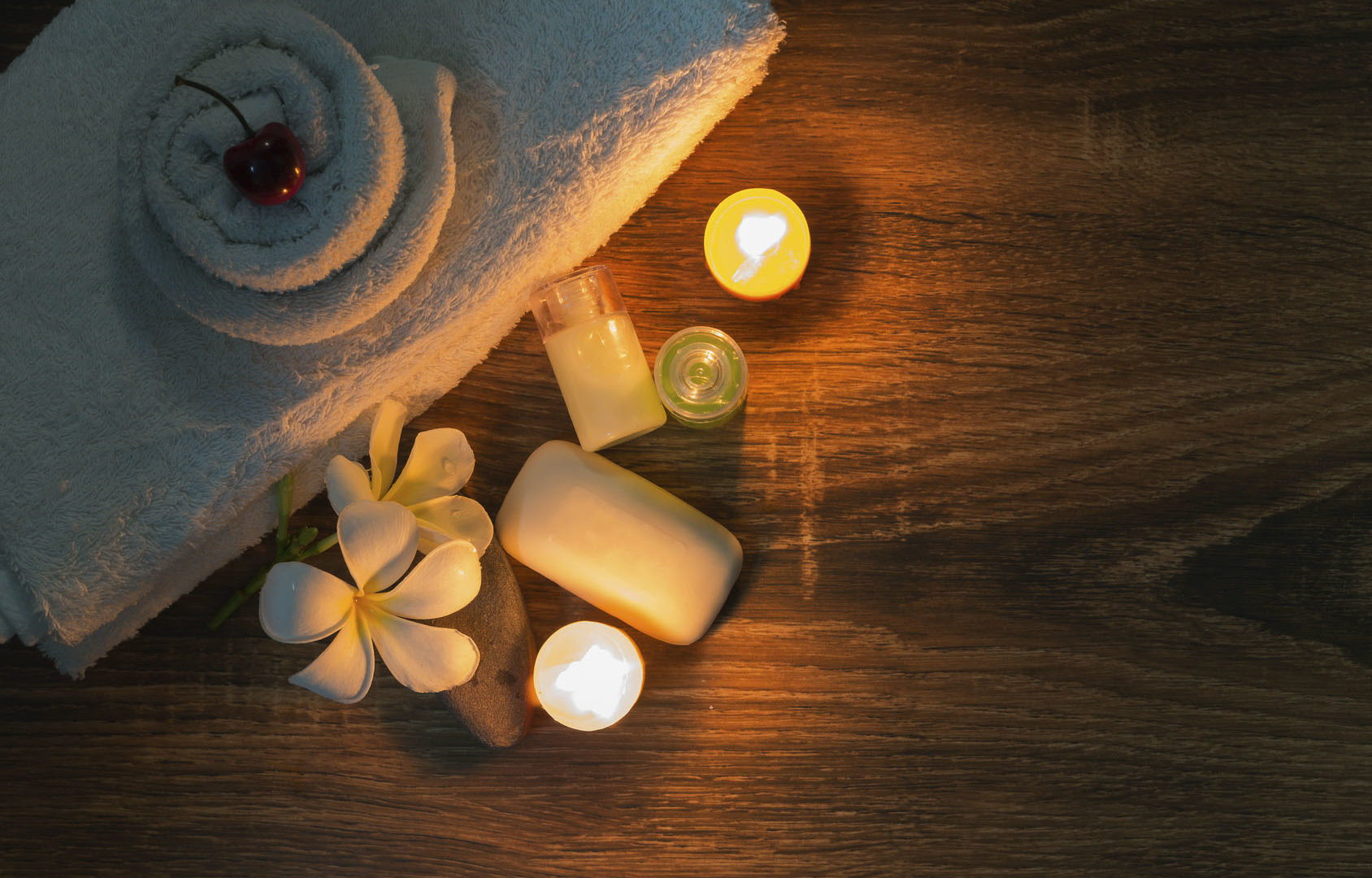 A home spa setting with natural soap and candles on night